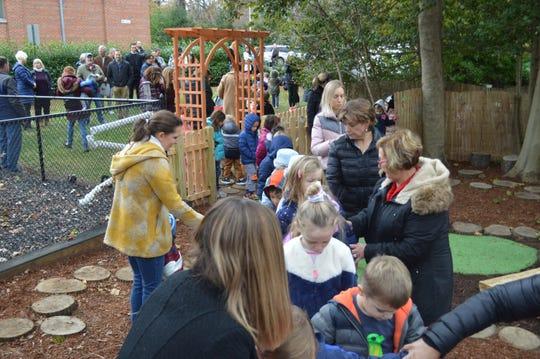 Ridgewood preschoolers explore an outdoor classroom Monday, Nov. 18.
