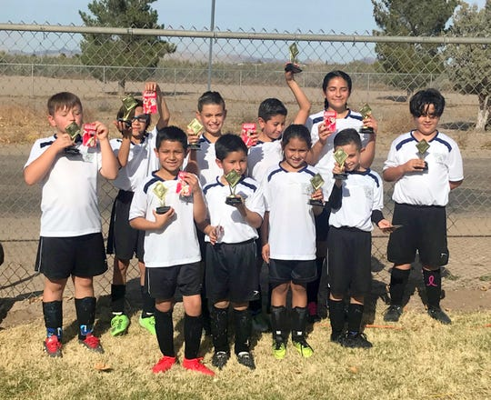 The White Robots of the U11 division of the Deming Youth Soccer League stood tall on November 9, 2019 by claiming the DYSL Division Championship at the DYSL fields during tournament Saturday. This final play-day capped an exciting 2019 regular season and team titles were handed out. The White Robots title win did not come easy as the Orange Traffic Cones put up a worthy challenge in a 2-1 White Robots championship victory. The team is, pictured in back row, from left, Coach Lloyd Valentine, Gabriel Lozano, Max Allison, Joel Rivera, Jayra Guerrero, and Jeremy Ibarra Chavez. In front, from left, are: Estevan Bustillos, Joseph Montellano, Abigail Cordova, and Dominic Marrufo. Not pictured is Mackenzi Laredo.