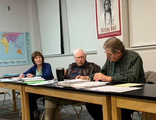 From left, Alma d'Arte charter high school governing council members Casilda Provencio, Godfrey Crane and Gene Elliott at the council's meeting at the school on Monday, Nov. 18, 2019. Crane and Elliott have both announced their retirement from the school's governing board.