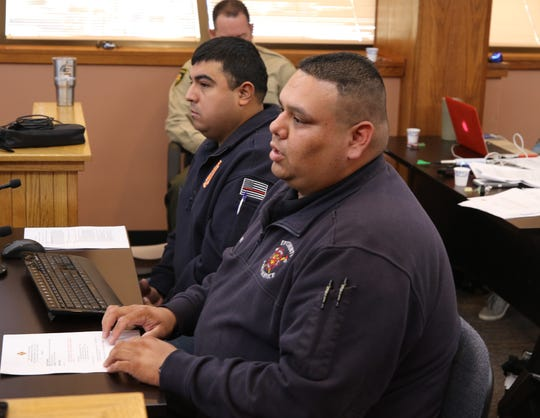 From left: Andres Holguin and Chris Chavarria of the Riverside Volunteer Fire Department discuss replacing a 22-year-old brush truck Nov. 19 during a meeting of the Eddy County Board of Commissioners in Carlsbad.