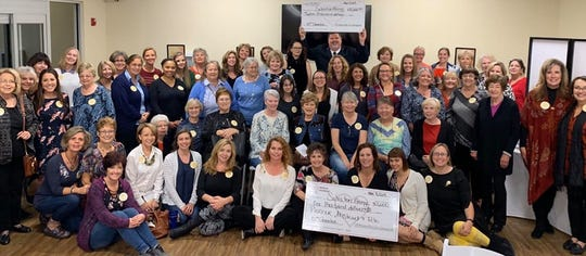 At the Nov.4quarterly 100 Women Who Care Alamogordomeeting, the groupdonated a total of $13,000 to Salvation Army.