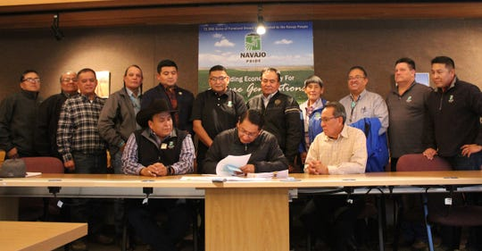 Navajo Nation President Jonathan Nez signs an agricultural lease for Navajo Agricultural Products Industry on Nov. 18 at the NAPI headquarters located south of Farmington.