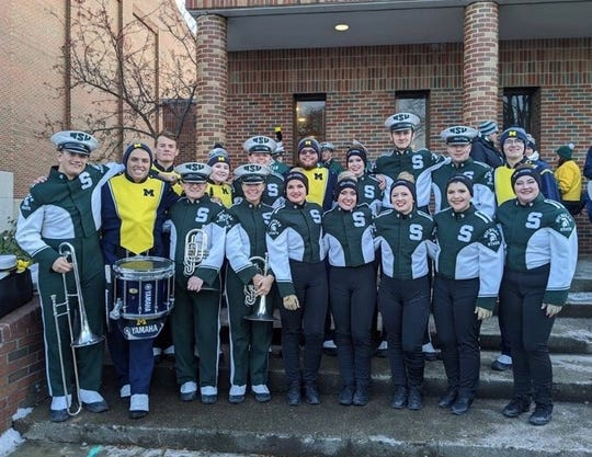 Pictured are the former PCEP marching band members who performed during the Nov. 16 Michigan State-Michigan football game.