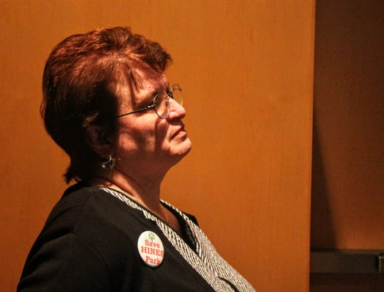 Nancy Darga of Northville listens during a public meeting put on by the Save Hines Park group.