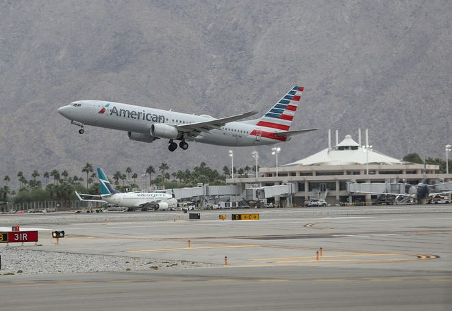 An American Airlines flight takes off Palm Springs International Airport, November 19, 2019.