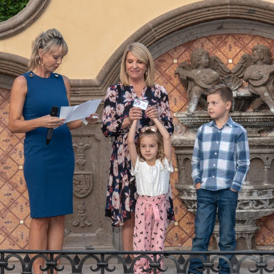 Heather Burton, with children Vivian and David and her mother, Debi Brooks, addresses the crowd.