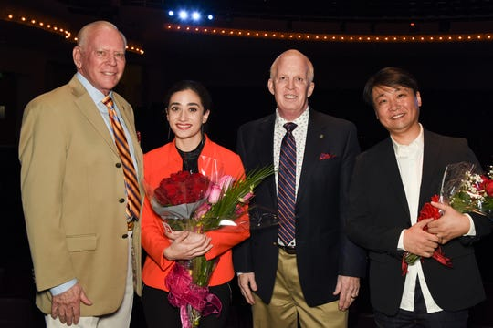 Sponsors Robert Archer and Charles Hilliar pose with grand prize and second place award winners Dolly Sfeir and Ye Li.