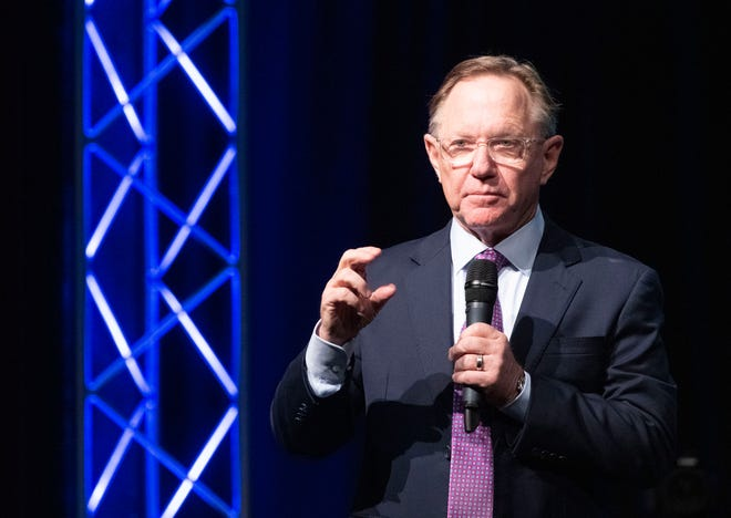 Quint Studer describes how to create a vibrant community before a capacity crowd at the REX Theatre during the CivicCon speaker series lecture in downtown Pensacola on Monday, Nov. 18, 2019.