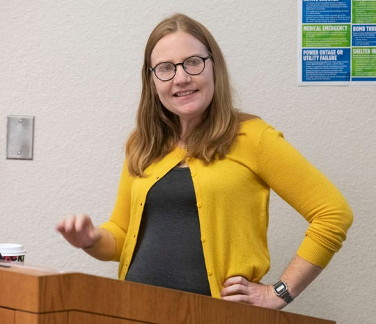 Donna Yates, an archaeologist specializing in antiquities theft, speaks to a group of students at the University of West Florida about identifying art and heritage crimes during her guest lecture Tuesday.