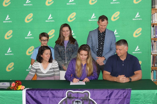 Pensacola Catholic's Mary Galloway (front, center) signs a beach volleyball scholarship with the University of Central Arkansas on Nov. 19, 2019.