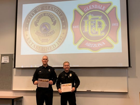 Glendale firefighter, Kyle Knight, and police officer, Ty Nowatzki, honored on Nov. 19 after rescuing people from burning apartment in September.
