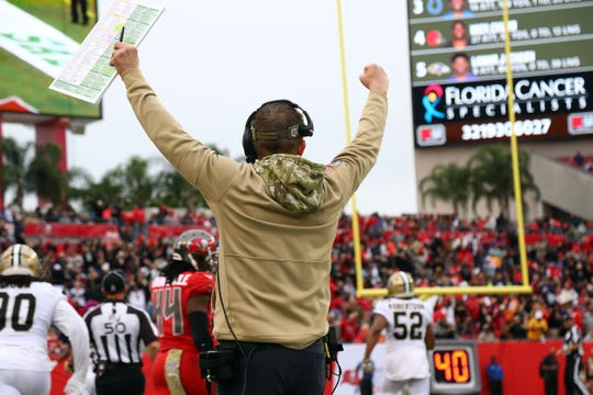 New Orleans Saints head coach Sean Payton celebrates after a Saints interception return for a touchdown against the Tampa Bay Buccaneers during the second half at Raymond James Stadium.