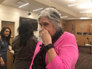 Plaintiff Gwen Aloia reacts on Nov. 19, 2019, after a jury in Phoenix decided that 10 of 21 plaintiffs who sued a now-shutteredPhoenix body donation company will be awarded $58 million.