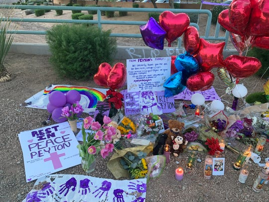 A memorial placed near the intersection of 144th Avenue and Indian School Road for 13-year-old Peyton Munger, who was fatally struck by a school bus on Nov. 15, 2019.