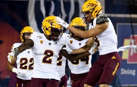 Arizona State wide receiver Brandon Aiyuk celebrates with teammates after running a punt back for a touchdown during the first half of an NCAA college football game against Oregon State in Corvallis, Ore., Saturday, Nov. 16, 2019.