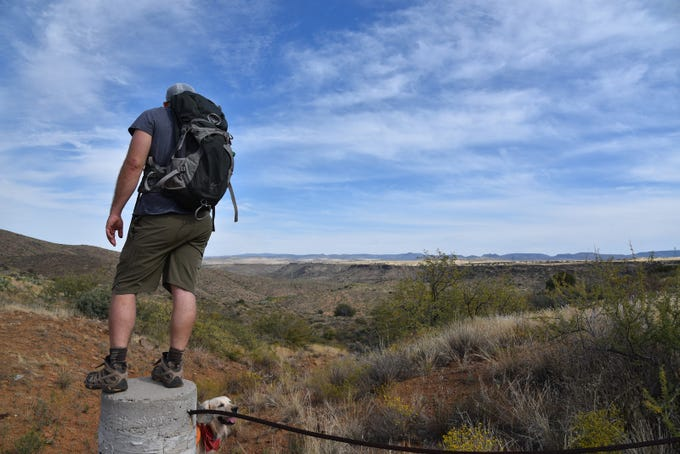 A hiker at an overlook above the Agua Fria River.