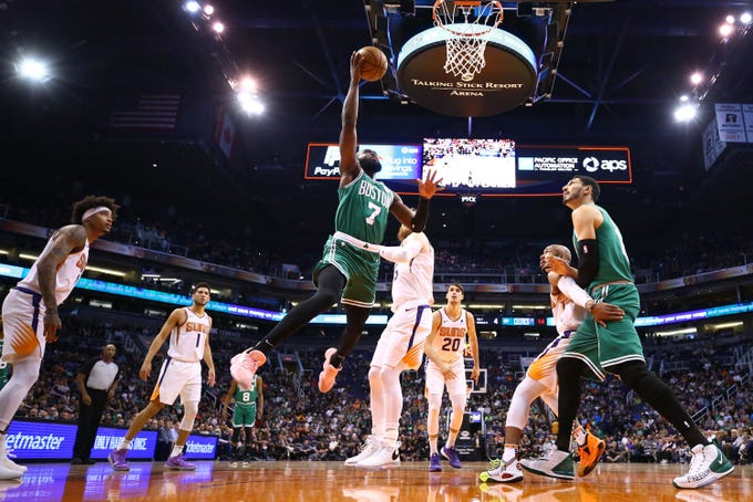 Boston Celtics guard Jaylen Brown (7) drives to the basket past Phoenix Suns center Aron Baynes (46) in the first half on Nov. 18, 2019 in Phoenix, Ariz.
