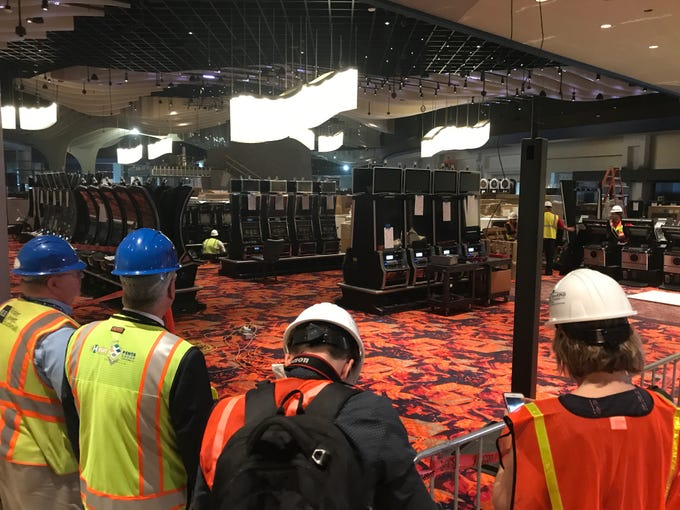 Leaders of the Desert Diamond West Valley Casino and journalists overlook the new gaming floor on Nov. 19, 2019.