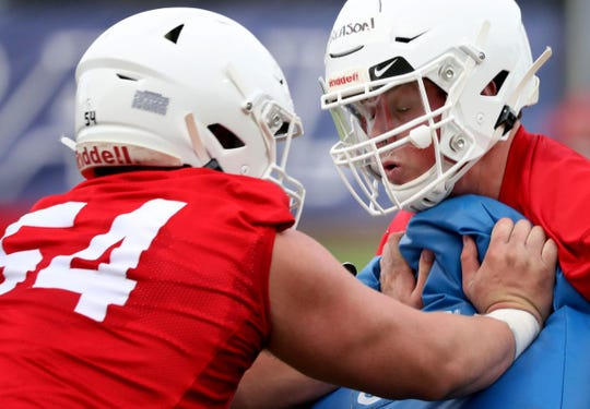 Starters Bryson Cain, left, and Cody Creason, right, both missed the game at Oregon last week.