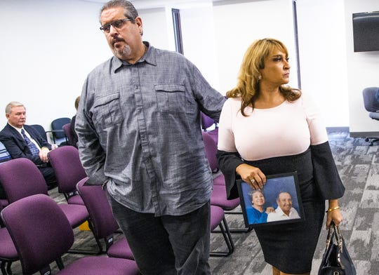 Stella Munoz, who sued Franklin Lambert over the handling of her mother's remains in 2011, leaves the hearing after Franklin Lambert, owner of Family Burial and Cremation in Mesa, appeared before the Arizona State Board of Funeral Directors and Embalmers in Phoenix on Nov. 19, 2019.