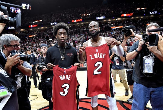 Heat guard Dwyane Wade exchanges jerseys with his son Zaire Wade after a game against the 76ers on April 9.