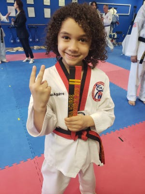 Lebanon resident Joshua Aguirre,, 7, became the world's youngest 2nd degree black belt in Taekwondo over the weekend.