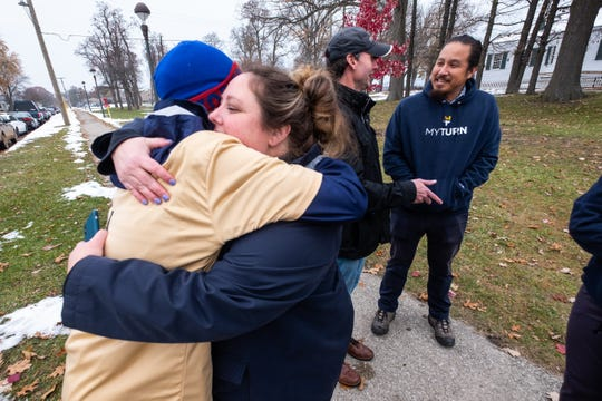 Jim Frank hugs Kate Voss Tuesday, Nov. 19, 2019, at Fort Gratiot Lighthouse. Voss came out to meet with Frank after he concluded. his nine-day run across Michigan to raise awareness and funds for ALS research.