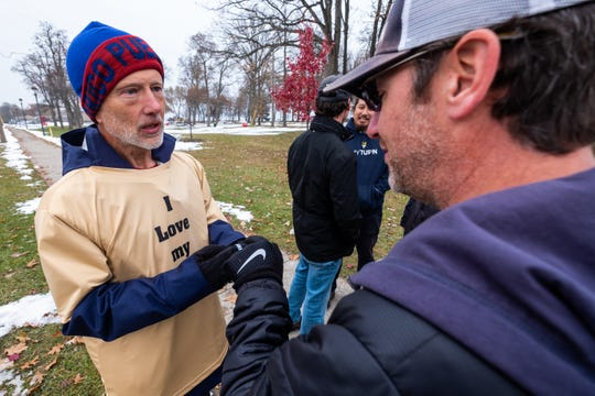 Jim Frank, left, fist-bumps Danny Pink after receiving a wristband for My Turn Tuesday, Nov. 19, 2019, at Fort Gratiot Lighthouse. Frank ran across Michigan to raise awareness and money for ALS research.