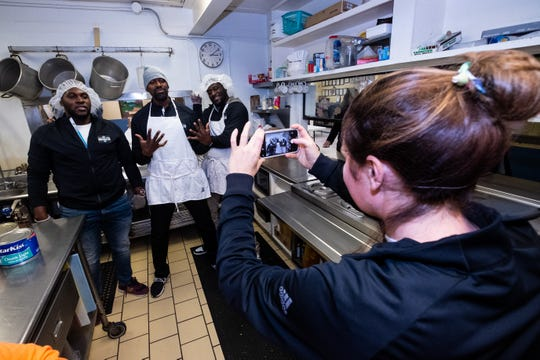 From left, former Detroit Lions Joique Bell and Herman Moore, along with former University of Michigan quarterback Devin Gardner pose for a photo in the kitchen at Mid City Nutrition Tuesday, Nov. 19, 2019. The former players, along with staff members from Fox Sports Detroit, visited the Soup Kitchen as part of their visit to Port Huron on the Football Week in Michigan Bus Tour.