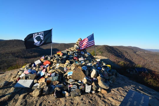 A rock monument dedicated to soldiers who have died in recent military conflicts is at the second viewpoint on the trail up to The Torne.