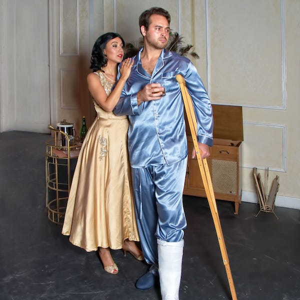 """Alina Gonzalez and Michael Rinere as Maggie and Brick are shown in County Players's production of """"Cat on a Hot Tin Roof"""" by Tennessee Williams."""