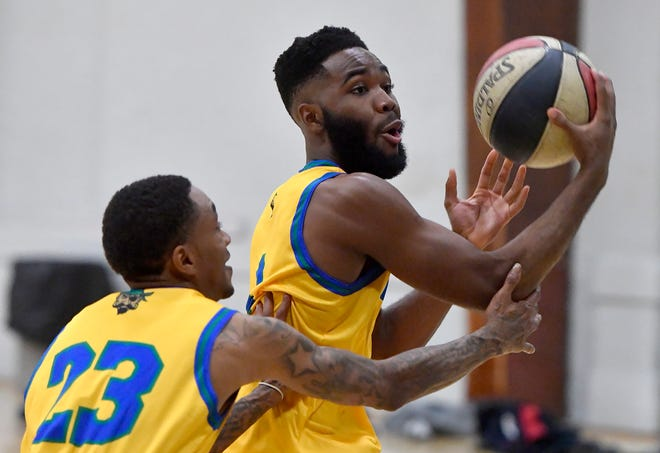 Jason Bady, right, of the semi-pro York Buccaneers basketball team makes a move on a teammate during practice at Voni Grimes Gym, Monday, November 18, 2019.John A. Pavoncello photo