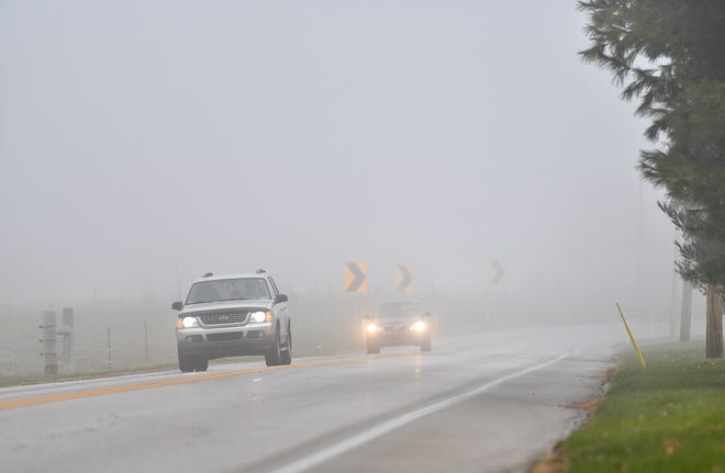 Traffic cuts through morning fog along Church Road in Manchester Township, Tuesday, Nov. 19, 2019. Dawn J. Sagert photo