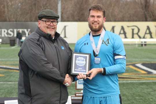 West York High School graduate Darian McCauley accepts the plaque recognizing him as the Pennsylvania State Athletic Conference Men's Soccer Tournament Most Valuable Player on Saturday.