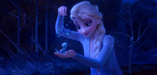 "Elsa, voiced by Idina Menzel, sprinkles snowflakes on a salamander named Bruni in a scene from ""Frozen 2."" The movie opens Thursday at Regal West Manchester, Queensgate Movies 13 and R/C Hanover Movies 16."