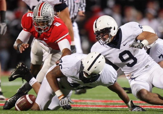 Ohio State quarterback Terrelle Pryor (2), Penn State linebacker Tyrell Sales (46) and safety Mark Rubin (9) chase the fumble during the fourth quarter of an NCAA college football game Saturday, Oct. 25, 2008 in Columbus, Ohio. The ball was recovered by Penn State. (AP Photo/Jay LaPrete)