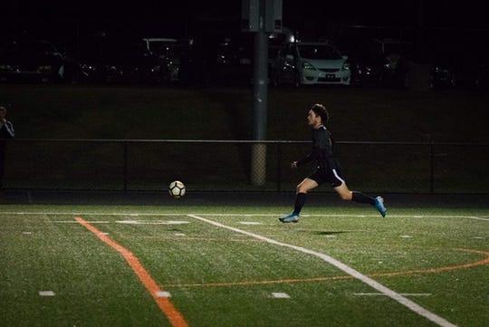 Shane Buss runs after a ball during a York Suburban soccer game this season.
