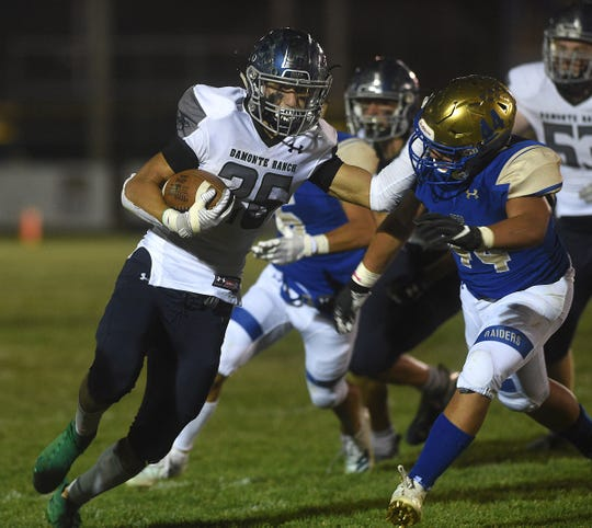Damonte Ranch's Ashton Hayes runs while taking on Reed during their game in Sparks on Sept. 27, 2019.