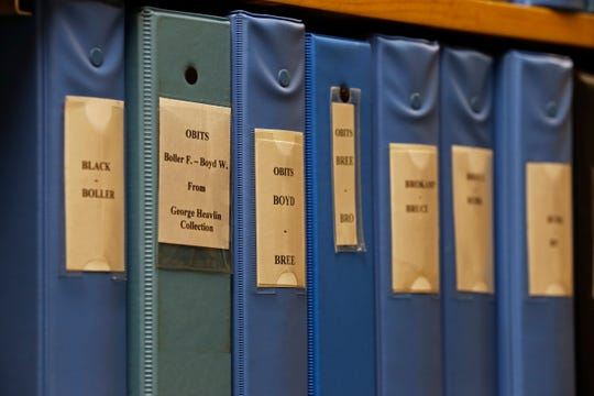 Binders full of obituaries sit on shelves at the new home of the Wayne County Genealogical Society.