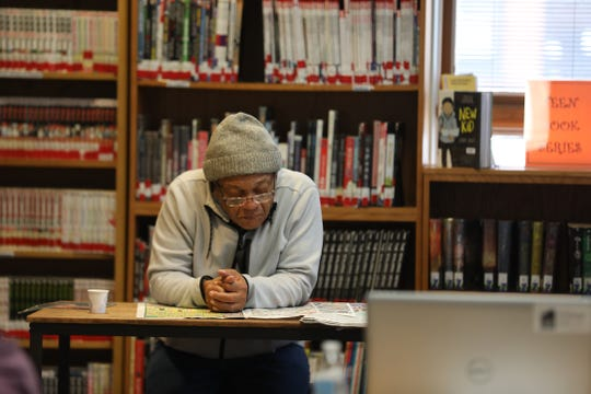 John George of Rochester reads the paper in the Lyell  Branch Library in Rochester on Nov. 17, 2019.