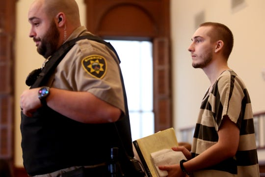 Quinlyn Harden, 25, of Independence, is escorted into the courtroom by a Polk County Sheriff's deputy for a sentencing after being found guilty of 29 counts of sexual abuse, rape, sodomy, attempted rape and unlawful sexual penetration at the Polk County Courthouse in Dallas on Nov. 18, 2019. Harden was sentenced to a total of 54 years and two months in prison for sexually abusing and raping five children at a Polk County day care run by his mother.