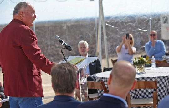 David Dillard, county judge for Concho County at far left, speaks during a groundbreaking ceremony at the site of the Maverick Creek Wind Farm north of Eden on Tuesday, Nov. 19, 2019.
