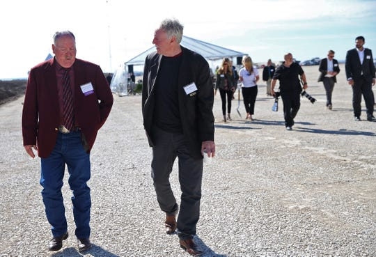 Concho County Judge David Dillard, far left, and Algonquin Power and Utilities Corp. CEO Ian Robertson, center, talk as they make their way to a groundbreaking ceremony at the site of the Maverick Creek Wind Farm north of Eden on Tuesday, Nov. 19, 2019.