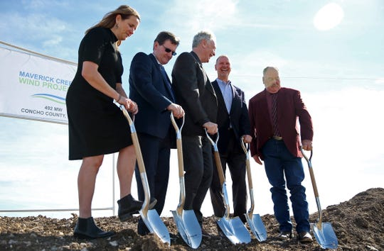 Guests pose for a photo with shovels at a groundbreaking ceremony at the site of the Maverick Creek Wind Farm north of Eden on Tuesday, Nov. 19, 2019.