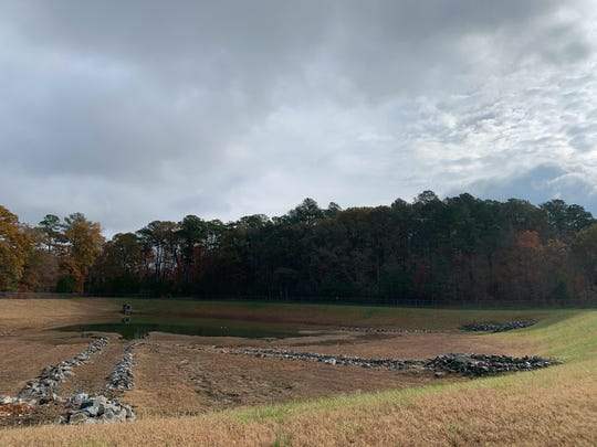The water retention pond adjacent to the Walmart Supercenter in Fruitland, Maryland, is getting a high-tech retrofit designed to combat Chesapeake Bay pollution. The pond is shown Nov. 19, 2019, prior to the technology's installation.