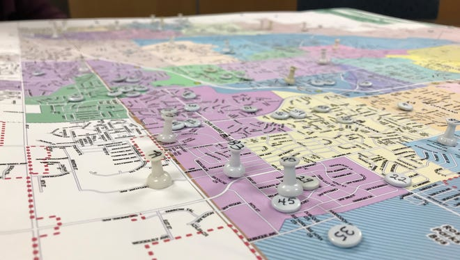 Pushpins on a map shows where applicants for a School Boundary Task Force are from within the Sioux Falls School District. The task force will help shape plans for the district to redraw attendance zones next year.