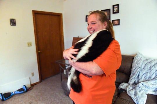 Heather Sondergaard holds her pet skunk, Marv, on Monday, Nov. 18, in Colton. Sondergaard got Marv as a baby from a pet breeder.