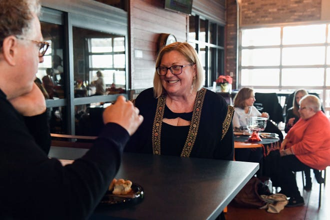 Christy Reiners chats with South Dakota Symphony director Delta David Gier at a fundraiser for In His Steps, a nonprofit aimed at providing breast cancer treatment and support to people living in the Holy Land, on Sunday, Nov. 17, at the Barrel House in Sioux Falls.