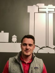 Michael Robinson is one of three pastors who lead worship services at Hill City Church, which meets in the Gillioz Theatre.