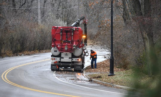 Crews respond to the scene of a sewage main break along Stearns County Road 1 near the Sauk River bridge Tuesday, Nov. 19, 2019.